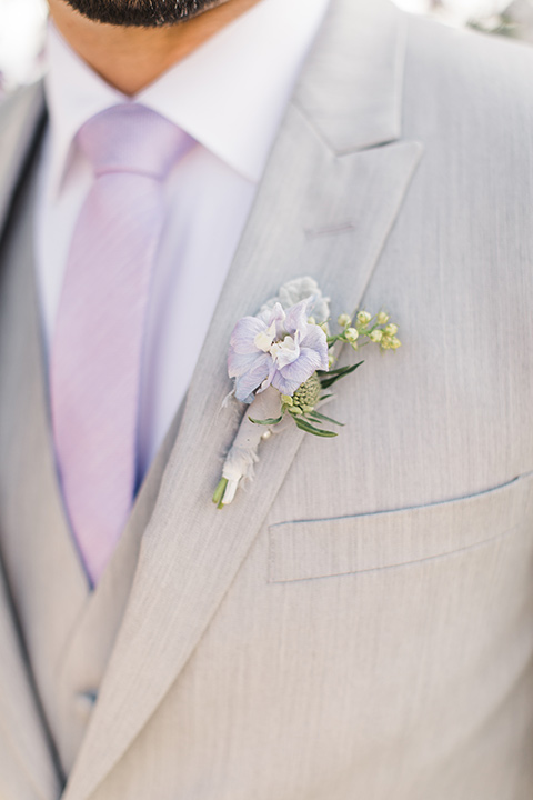 groom in a light grey suit with a lavender long tie