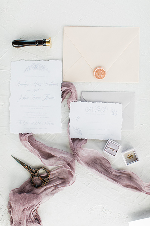 white and lilac colored invitations with gold lettering