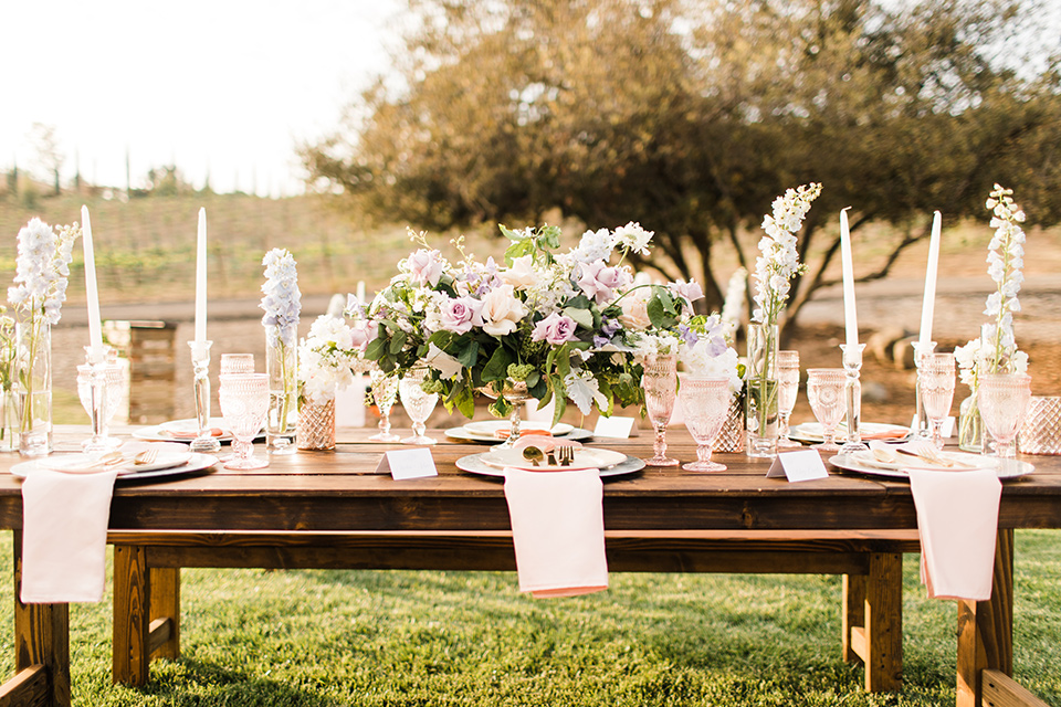 reception tables with tall white candles and linens