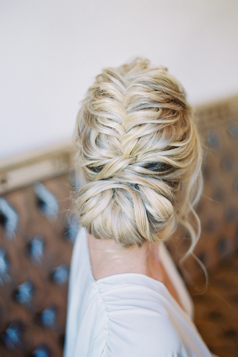 bridal hair in a fishtail bun