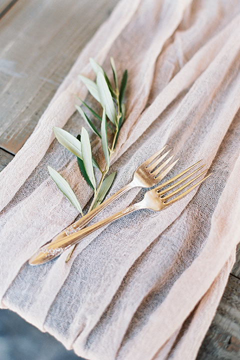 gold flatware with sage and blush linens