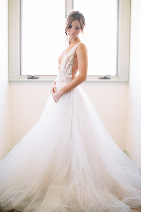 bride in a long flowing gown with long sleeves and a plunging neckline