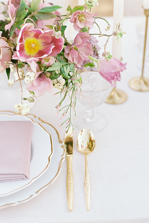 gold and mauve flatware and linens