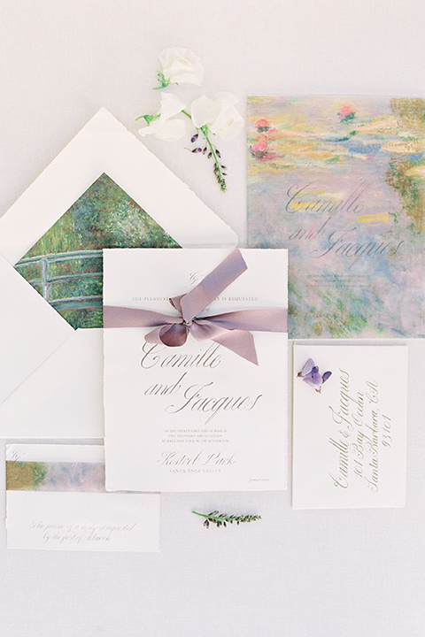 white invitations with floral details