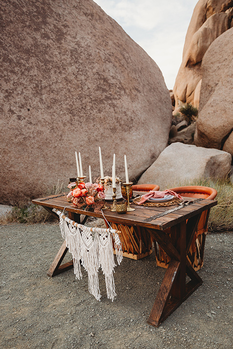 bohemian sweetheart table set up with wood table and macrame