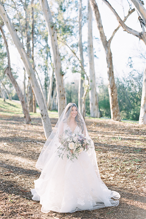 bride in a ballgown with a plunging neckline and a veil