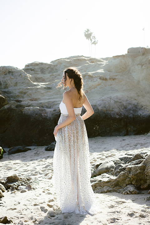 bride in  flowing gown with embellishments