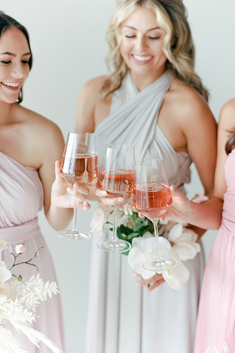 bridesmaids in several shades of pastel