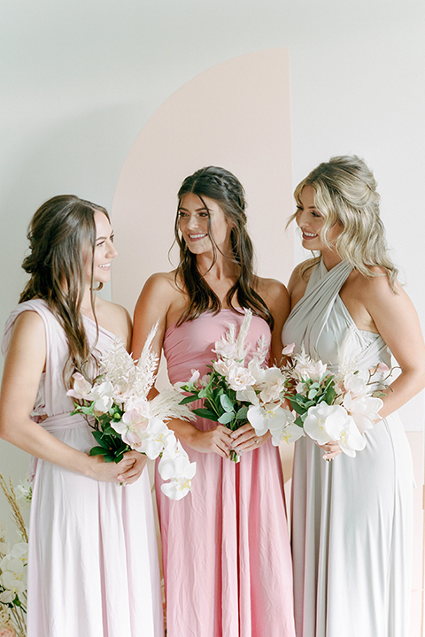 bridesmaids in different shade of pastels