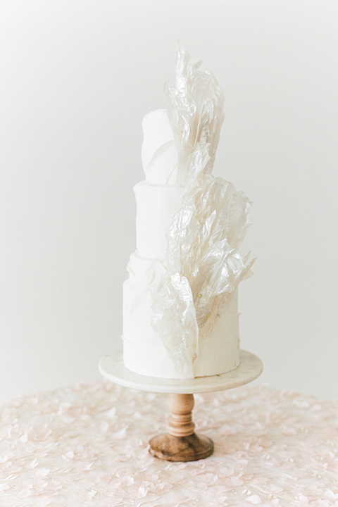 white three-tiered cake with modern design