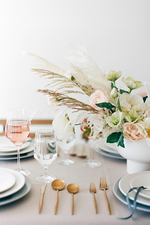 modern tablescape with white linens and gold flatware