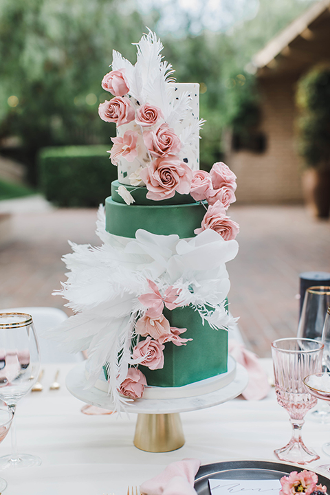 cake with pink and green flowers