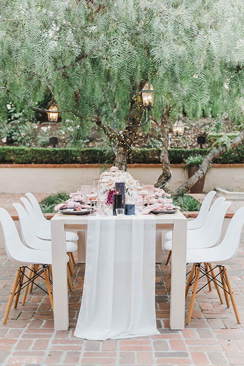 reception table with pink and white linens and flowers