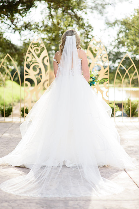 the bride in a white full ball gown with straps