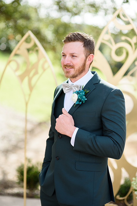 groom in a grey asphalt suit with a grey bow tie
