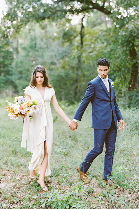 ruffled shoot in texas – bride in a romantic casual wrap dress and the groom in a blue suit with a white long tie