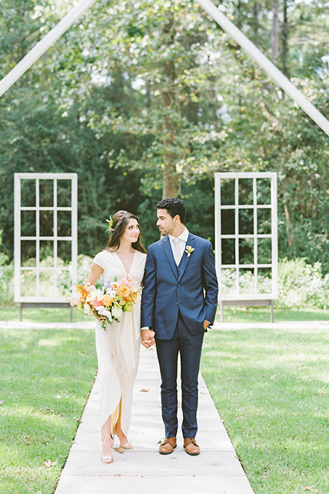 ruffled shoot in texas – bride in a romantic casual wrap dress and the groom in a white long tie