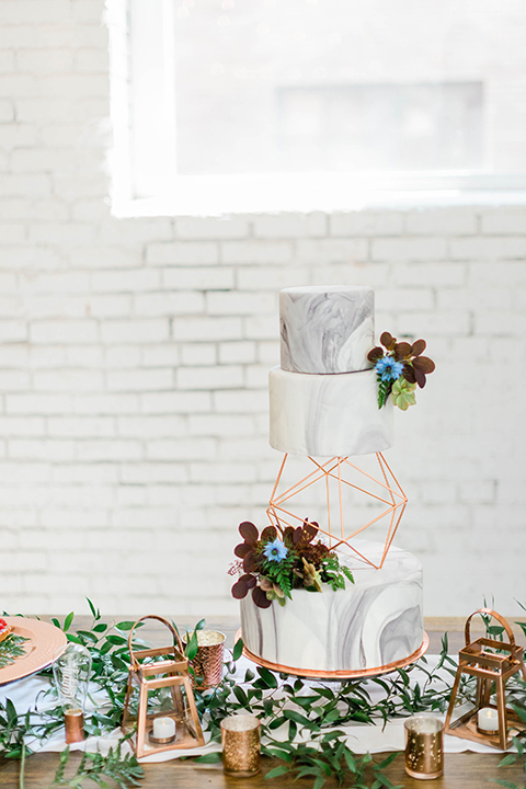 modern white and marble design cake with gold details